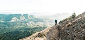 trailblazing - person walking on a mountain path