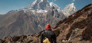 man on a journey through mountains - enjoy the journey