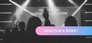 woman lifting hand in worship - praise